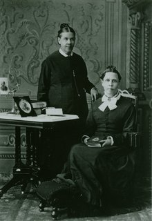 Ellen G. White (standing) and her fraternal twin sister, Elizabeth N. Bangs, circa 1878