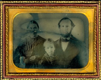 Ellen G. White and James White with son, W. C. Willie White, circa 1857